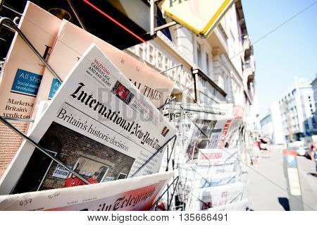 STRASBOURG FRANCE - JUN 24 2016: International New York Times and other major newspapers headline titles at press kiosk about the Brexit referendum in United Kingdom which has decided the country wishes to quit the European Union