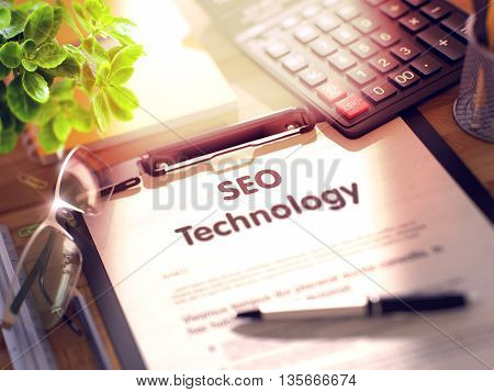 Clipboard with Business Concept - SEO Technology on Office Desk and Other Office Supplies Around. Clipboard with Concept - SEO Technology with Office Supplies Around. 3d Rendering. Blurred Image.