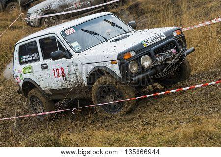 Lviv Ukraine - February 21 2016: Off-road vehicle brand VAZ - NIVA (No. 123) overcomes the track on a amateur competitions Trial near the city Lviv Ukraine