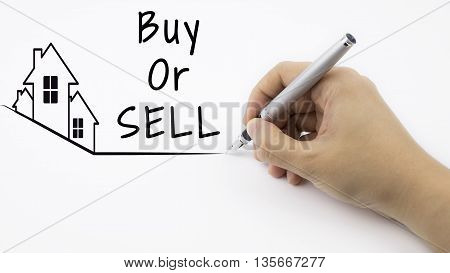 Buy or SELL - Real Estate concept with female hand and pen
