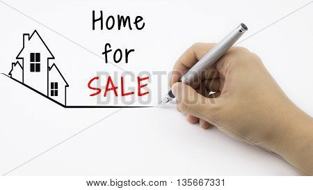 Home For SALE - Real Estate concept with female hand and pen