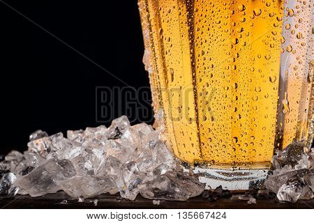 Pitcher of beer with ice - detail