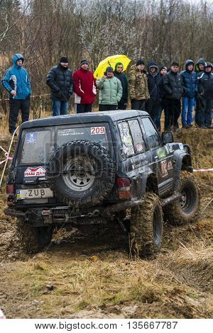Lviv Ukraine - February 21 2016: Off-road vehicle Nissan overcomes the track on of landfill near the city Lviv.