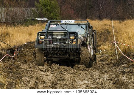 Lviv Ukraine - February 21 2016: Off-road vehicle UAZ overcomes the track on  landfill near the city Lviv.