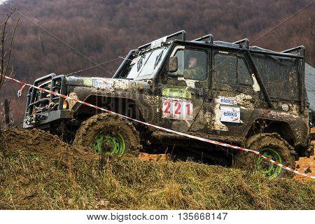 Lviv Ukraine - February 21 2016: Off-road vehicle UAZ (No. 221) overcomes the track on  landfill near the city Lviv.