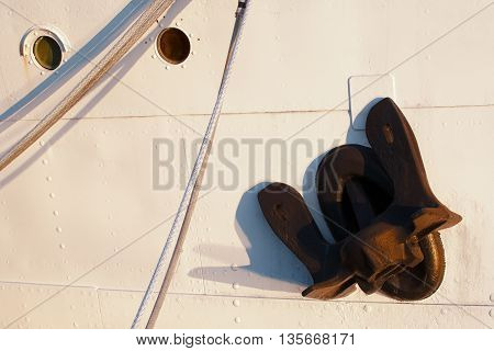 Closeup view of  ship anchor and portholes .