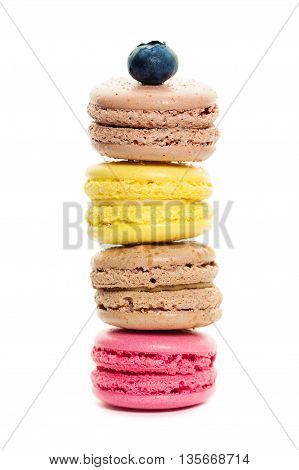 four tasty Colorful Macaroons on White Background
