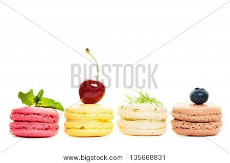 four French Sweet Macaroons on White Background