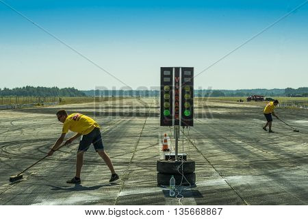 VinnytsiaUkraine-July 26 2015: Employees of the Federation of Automobile Sports prepare the track for the races of the Drag championship of Ukraine on July 262015 in Vinnytsia Ukraine.