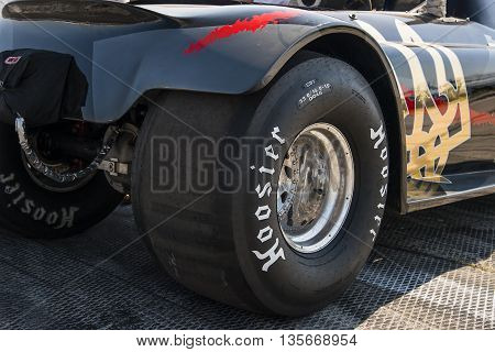 VinnytsiaUkraine-July 26 2015: Rear wheels drag car parked in a park-service before the races of the Drag championship of Ukraine on July 262015 in Vinnytsia Ukraine.