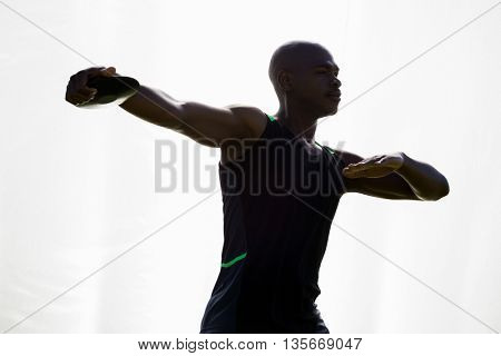 Athlete about to throw a discus in stadium