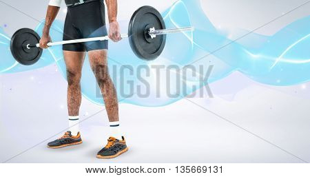 Mid-section of bodybuilder lifting heavy barbell weights against grey background