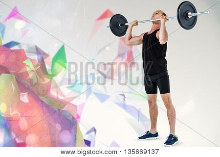 Bodybuilder lifting heavy barbell weights against colourful abstract design