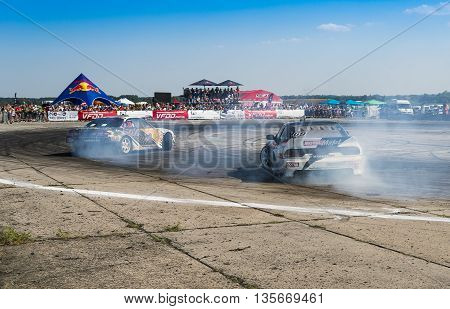 VinnytsiaUkraine-July 25 2015: Unknown riders on the cars brand Nissan overcomes the track in the Drift championship of Ukraine on July 252015 in Vinnytsia Ukraine.
