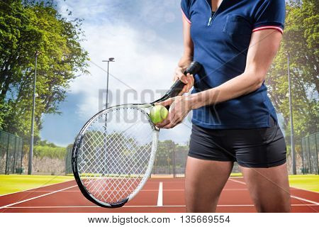 Tennis player holding a racquet ready to serve against composite image of tennis field on a sunny day