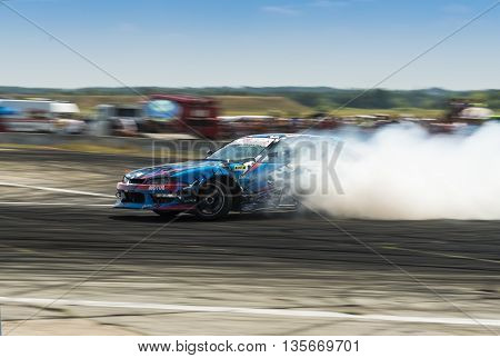 VinnytsiaUkraine-July 25 2015: Unknown on the car brand Nissan overcomes the track in the Drift championship of Ukraine on July 252015 in Vinnytsia Ukraine.