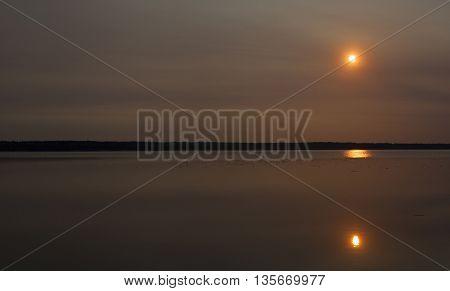 Sun coming up in an overcase sky in Saskatchewan Canada