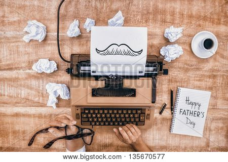 Hands using typewriter for fathers day