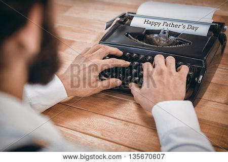Man using a typewriter for fathers day