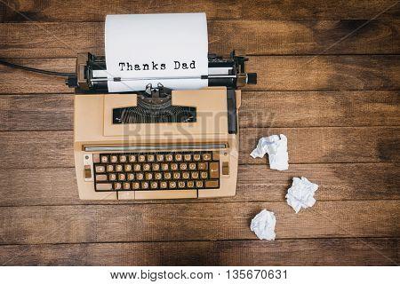Thanks dad written on paper with typewriter