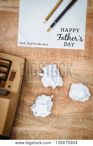 Happy fathers day written on paper next to typewriter