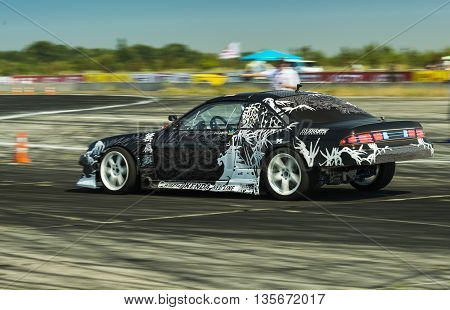 Vinnytsia Ukraine-July 25 2015: Unknown rider on the car brand Nissan overcomes the track in the Drift championship of Ukraine on July 252015 in Vinnytsia Ukraine.