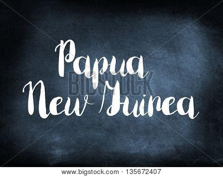Papua New Guinea written on a blackboard