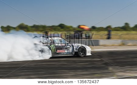 Vinnytsia Ukraine-July 24 2015: Rider Dmytro Illyuk on the car brand Nissan overcomes the track in the Drift championship of Ukraine on July 242015 in Vinnytsia Ukraine.