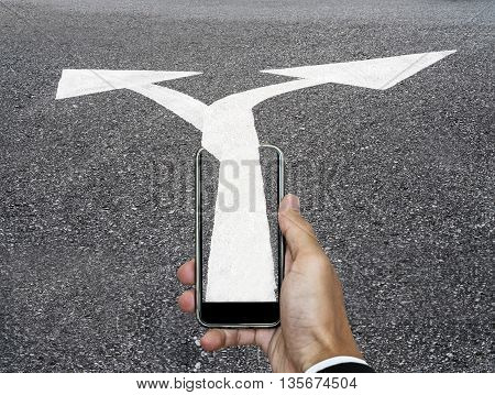 Hand with smart phone and two way arrow directions from phone to road, business concept