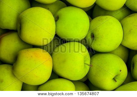 fresh green apples lying in heap on food background healthy eating dieting