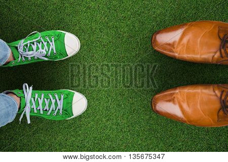 Casual shoes against close up view of astro turf