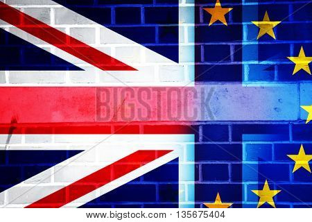 British Union jack flag and EU flag painted on cracked brick wall