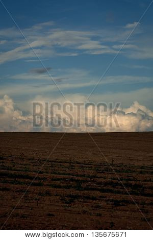 Blue Sky With Clouds And Agricultural Ground
