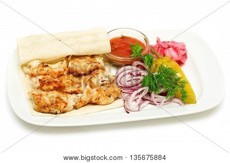 Chicken meat barbecue with marinated vegetables and onion