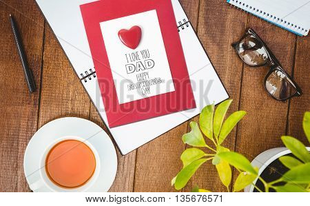 fathers day greeting against close up view of business stuff