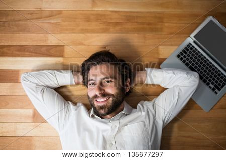 Man lying on the floor with his laptop