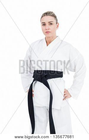 Female athlete posing in kimono on white background