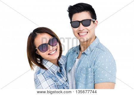 Happy young couple smiling on white background