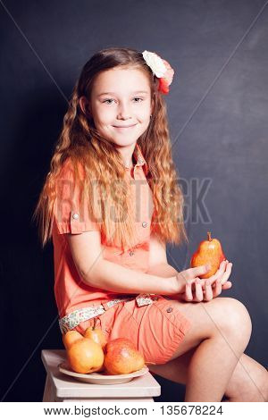 Young Girl holding Pears Fruit on black