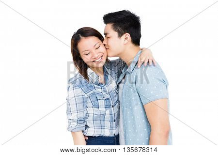 Happy young couple hugging and kissing on white background