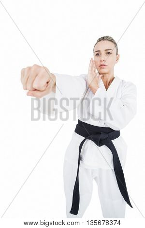 Female athlete practicing judo on white background