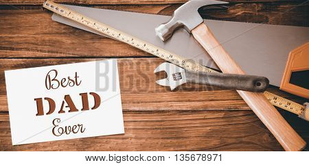 Best dad ever message next to tools on wooden background