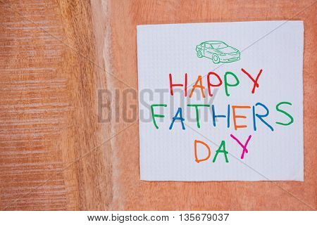 Word happy fathers day on white background against view of tissue on desk