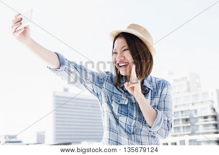 Young woman taking a selfie on smartphone