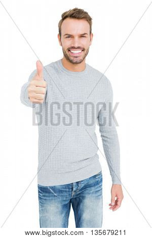 Portrait of a happy young man smiling and giving a thumbs up on white background