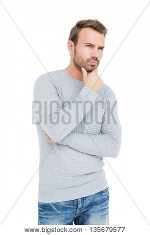 Young man looking confused on white background