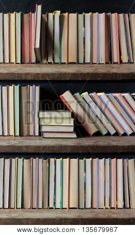 Bookcase books on the shelves close up. Library. Back to school.