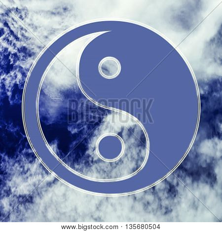 The symbol of Yin - Yang in the background of sky and clouds