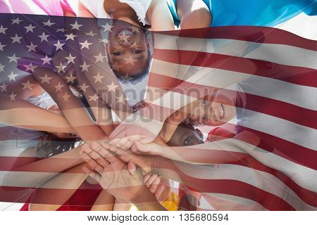American flag against children hands stacked