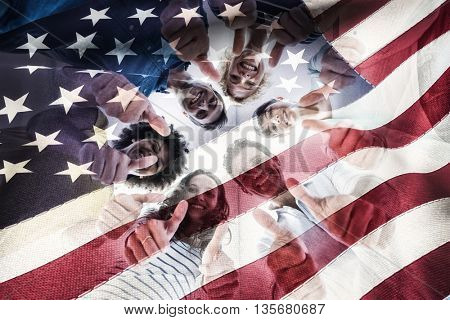 Cropped American flag against creative team gesturing thumbs up